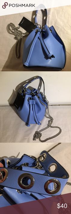 🎉Host Pick🎉NWT Zara Mini bucket cross body bag Super cute never even unpacked. Color is a periwinkle blue with silver tone hardware. Chain detaches so can be cross body or bucket. Grommet detail on hand strap. Diameter of bag bottom is about  6 inches bag height about 7. Handle is about 10 inches and chain is about 38. No dust bag. Zara Bags Mini Bags