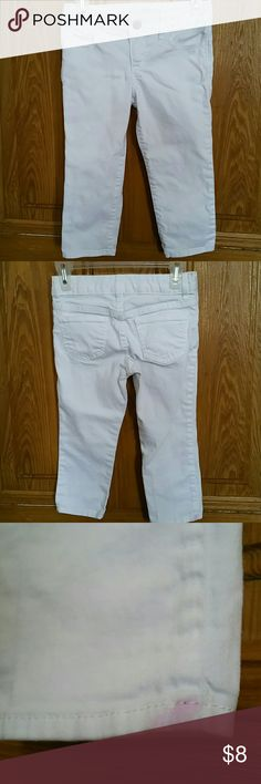 White Denim Capri Jeans by Gap Kids. Size 6. Hello Posh Community! These are cute white Capri Jeans by Gap Kids. They are a size 6. There is a slight pink stain at the back of the bottom right leg. Please look at photos. Thanks for looking. GapKids Bottoms Jeans