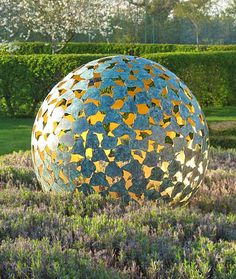 Try this with clay balls? What would it look like to have a field of these lit up? #outdoorsculpture