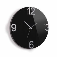 Umbra Elapse Wall Clock, High-Gloss Black has a unique design and adds character to your room or any space it occupies. This wall clock is appreciated for its cast-metal numbers and sculptural dimension. This clock was designed by Alan Wisniewski. High-Gloss Black