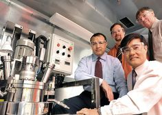 Argonne battery researchers (from left) Khalil Amine, Chris Johnson, Sun-Ho Kang and Mike Thackeray flank a continuously-stirred tank reactor used to produce scaled-up quantities of cathode materials for lithium-ion batteries. Thackeray, Johnson, Amine and Jaekook Kim (not pictured) are co-inventors of a revolutionary cathode material used in the battery that powers GM's Chevrolet Volt.