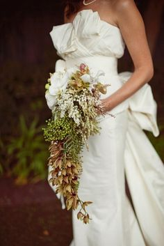 bride, wedding, white dress with green and brown tones flowers