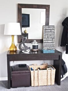 cute little entry table. love the ampersand, chalkboard change apothecary jar & life subway art!