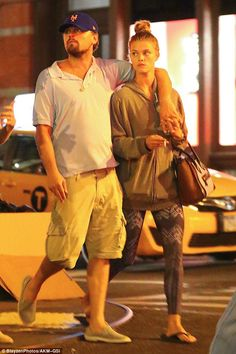 Proud as punch: Leonardo DiCaprio put an arm around girlfriend Nina Agdal as they headed to dinner to celebrate her big new modelling deal in New York City on Thursday