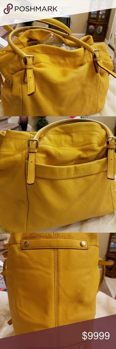 ♠Kate Spade 🚕Taxi Cab🚖 Yellow Duffle ♠Kate Spade Vibrant & Bright🚖Taxi Cab💛Yellow LG Drawstring Soft Sider Duffle Tote. Beautiful & Soft Pebbled Leather. Protective bottom feet. Silvertone hardware. Grommet sides/sliders adjusts size of bag. Open top bag. Overall, for bag age, great condition! Light marks (pics) but not too noticeable. Inside, stripe lining has a bit of ink very bottom. Lg out pocket, & 2 inside, 1 zip pocket. Handles see (pic).  This would be adorable with Jeans, Black…