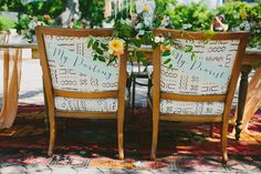 chair back signs - photo by Amber Vickery Photography http://ruffledblog.com/late-summer-bohemian-inspiration
