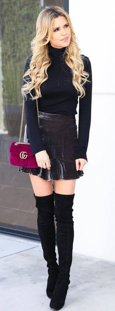 what to wear with over knee boots : black top + skirt + velvet bag