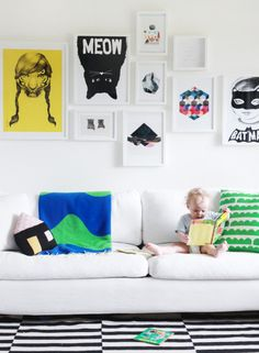 This gallery wall is so hip with its white-on-white style and bold graphic prints.
