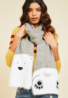 Blustery day? You say 'bring it on' with this fuzzy grey scarf from Yumi! Decorated at one end with a polar bear face and on the other with paws and a pom-pom tail, this quirky accessory - inspired by London street fashion - motivates you to see the sunshine through the clouds!