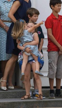 Princess Isabella carried her baby sister  Princess Josephine while Prince Felix (L) and oldest brother Prince Nikolai (R) are standing by during Danish annual photo session at Graasten Palace in Jutland on 26 July 2013