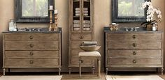 antique weathered oak vanities with dark gray marble sink tops and mirrors....master bath