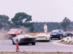1966 12 Hours of Sebring - Ferrari 250 GTO goes of piste, taken by Corvette, Porsche 906 and Ford GT40.