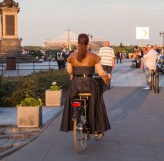 Twenty20 ~ Afternoon bike ride in my fancy dress. Woman in a brown dress on a…