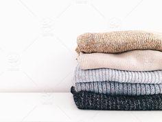 stock photo, white-background, fashion, stack, clothes, background, wardrobe, sweater, organizing, neatly-organized, knitted-sweater