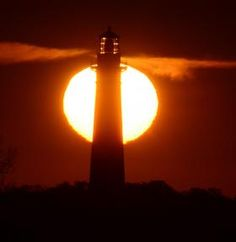The Sun rises behind the St. Augustine Lighthouse