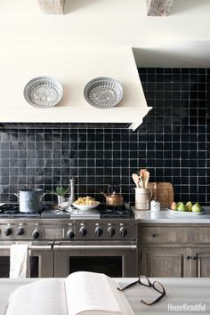 Black glazed tile from Compas Stone makes a graphic backsplash in this California kitchen designed by Chris Barrett.
