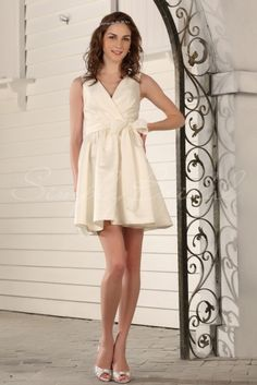 Wedding Dress by SimplyBridal. A mini alternative to the wedding dress, this cute number is fun and classy in equal measures. The cross-over surplice bodice has a grown-up feel and is complemented by a more formal satin fabric. A box pleated skirt and bow tied neatly on the waistband a. USD $159.99