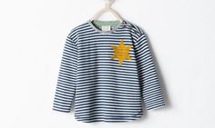 Zara removes striped pajamas with yellow star following online outrage.