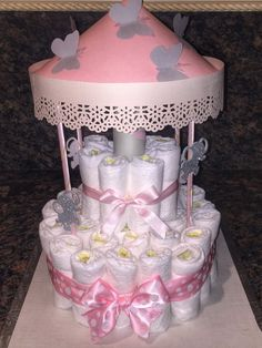 Items similar to 2 Tier Carousel Diaper Cake on Etsy
