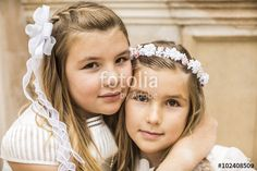 Two happy girls on the day of her First Communion
