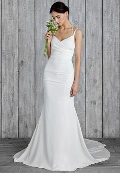 Nicole Miller Taylor is a modern-inspired bridal gown is made of crepe de chine, an airy and lightly textured silk. It features beaded Straps that go into the back of the gown. This gown is brand new with tags. Nicole Miller Taylor is Antique White and a size 12.