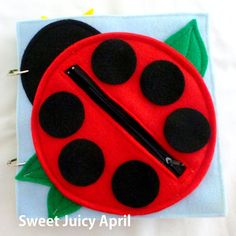 A cute ladybug with a zipper. Your child can match the spots to the outlines on the outside of the ladybug and then store the spots inside the ladybug when done playing. The zipper pouch can also be used for storage of other quiet book items when not in use. This can also be made