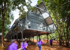 A secondary school in Thailand by Vin Varavarn Architects is shaped like a roof and raised above the ground on metal stilts.