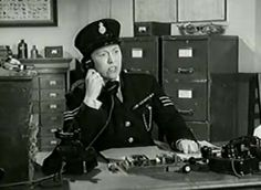 0 Peggy Mount as Sergeant Fire on the phone in dry rot 1956