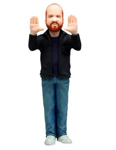 Joss Whedon action figure. You know you're the god of geeks when they make an action figure of you!