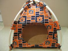 Auburn Tigers Handmade Fabric Pup Tent Pet Bed.Avail @ http://stores.sharonsdecoratedbooks.com/ Beds r made when ordered and payment is received. The average time that it takes for the Bed to ship after payment is usually 5 biz days. The Pet Beds are made of licensed cotton NCAA College material, but are not licensed by the NCAA College. They are handcrafted and resold under rights granted by the 1st sale doctrine. We are not affiliated with The Licensed Company in any way. ***22$ Sm  27$ Lg