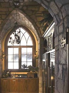 wish it was a bigger photo so I could really check this gothic style kitchen out!