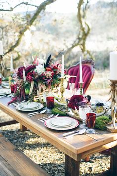 What a beautifully rich in color table. Would be a beautiful fall decor option.   Moody forest wedding tablescape