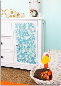 Sea glass door on this dresser is AMAZING.