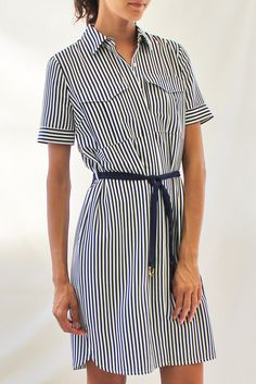 This shirt dress features a belt tie, button closure, two front chest pockets, and a vertical stripe pattern. Content + Care: - 100% Polyester - Hand Wash Cold, Hang To Dry - Made in China