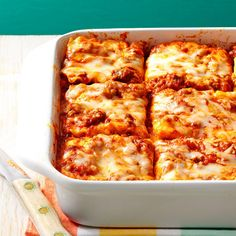 Make Once, Eat Twice Lasagna Recipe -Our family loves this recipe accompanied with a green salad and garlic bread. It is so handy on lazy days or when guests arrive to have an extra, ready-made pan in the freezer. —Geri Davis, Prescott, Arizona