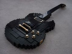 A guitar collection of cool electric and acoustic guitars from around the world combining art, design and playability.