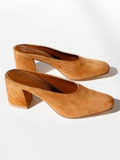 "Classic mule in smooth leather with a slightly squared toe and 2 5/8"" block heel. Slips on. Fits true to size. Made in Turkey. Color: Whiskey Suede"