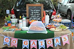 Tailgate ideas: AstroTurf table runner, DIY flag banner and home team quote on chalkboard