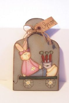 Primitive Easter Spring Bunny Carrots Wood Plaque Handpainted Home Decor. $12,95, via Etsy.