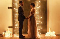 Love this candle and bistro light ceremony backdrop- so romantic! Industrial Winter Wedding Inspiration Photo Shoot in Portland Oregon Photos by Brittany Lauren Photography, Designed by Champagne Wedding Co...