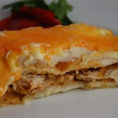 A spicy chicken and chile pepper mixture is blended with a creamy soup mixture, rolled up in flour tortillas, and baked with Cheddar cheese on top. This is an easy chicken enchiladas recipe that you will love.