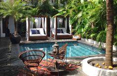 Lush global pool and cabanas