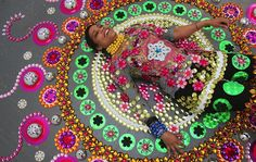Kaleidoscopic installations made of thousands of pieces crawl across floors, walls, and people by Suzan Drummen