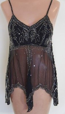 beaded tunic-could use with any silky black pants.