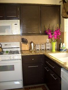 Paint your honey oak cabinets brown. Update hardware and you have a new kitchen.