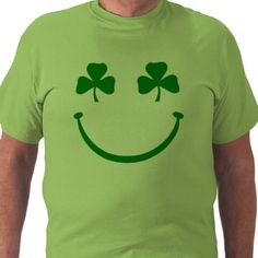 A funny Saint Patrick's Day T-shirt featuring a smiley face design with shamrock eyes