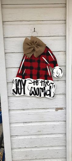 It is hand-cut out of 1/4 inch Sanded Plywood, painted with acrylic paint, and finished with a protective clear coating that prevents chipping, peeling, or fading. It hangs from sturdy metal wire, and it is accessorized with a multi-layered Colorful bow Christmas Door, Christmas Signs, Christmas Projects, Christmas Time, Xmas, Christmas Ornaments, Christmas Ideas, Christmas Decorations, Wooden Door Hangers