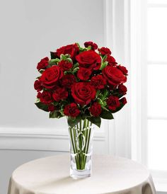 Brilliant red roses are brought together with burgundy mini carnations and lush greens and presented in a designer clear glass vase to create a bouquet that speaks of your heart's every wish. Flowers Nature, Fresh Flowers, Cheap Flowers, Valentine's Day Flower Arrangements, Hot Pink Roses, Red Roses, White Roses, Mini Carnations, Order Flowers Online