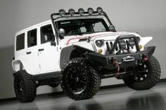 2013 Jeep Wrangler Unlimited Kevlar Coated Lifted Jeep. Love the lights, suspension, and tires