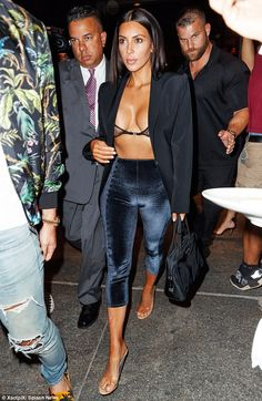 Such a beauty: Kim Kardashian stepped out in a barely there look for dinner with her frien...